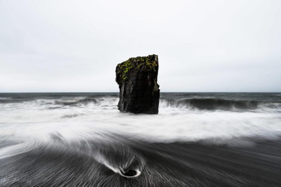 Sea stack on a black beach