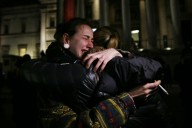 Woman cries during a vigil to pay tribute to the victims of a shooting by gunmen at the offices of weekly satirical magazine Charlie Hebdo in Paris, at Trafalgar Square in London