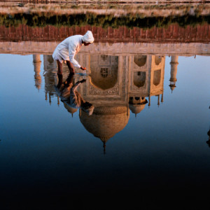 Reflection in the Yamuna River of the Taj Mahal, completed in 1638 by the Mughal emperor Shah Jahan after the 1629 death of his favorite wife, Mumtaz Mahal.Agra, India, 1999.