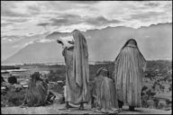 "Henri Cartier-Bresson - Magnum Photos - ""India, Kashmir, Srinagar - 1948 - Muslim women on the slopes of Hari Parbal Hill, praying toward the sun rising behind the Himalayas"""