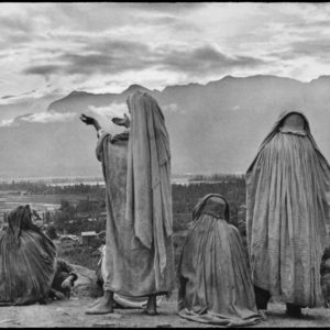 "Henri Cartier-Bresson - Magnum Photos - ""India, Kashmir, Srinagar - 1948 - Muslim women on the slopes of Hari Parbal Hill, praying toward the sun rising behind the Himalayas"""