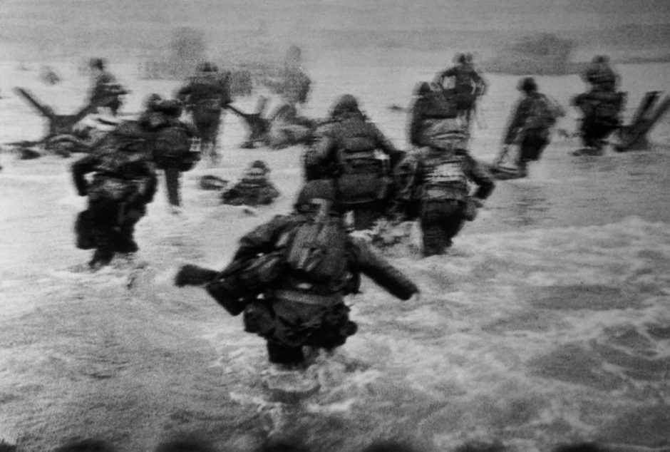 "Robert Capa - Magnum Photos - ""France, Normandy, W.W.II. Operation OVERLORD - Omaha Beach - June 6th, 1944 - The first wave of American troops lands at dawn"""